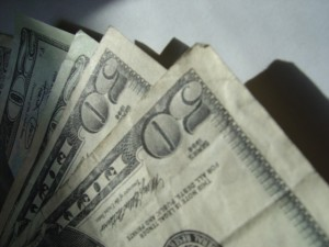 money photo of several fifty dollar bills