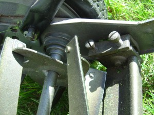 closeup photo of push reel lawn mower blades showing adjustment screws