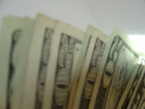 blurry photo of money - twenty dollar bills