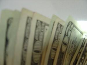 blurry photo of money - twenty dollar bills
