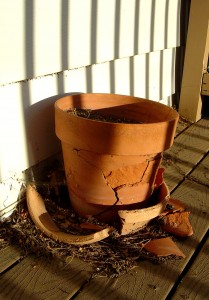 photo of a broken terra cotta flower pot in the sunlight