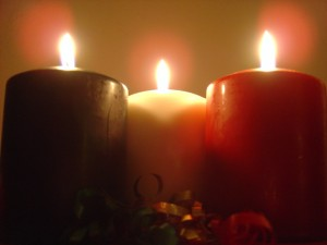 photo of three green white and red burning holiday christmas candles