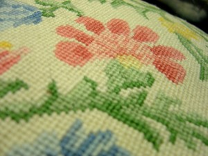 phot of embroidery needlepoint on pillow
