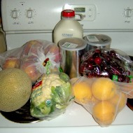 fruit milk vegetables and other groceries sitting on the stove