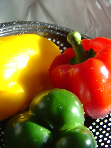 photo of three bell peppers red yellow and green