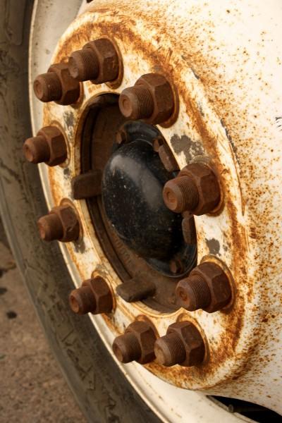 Free closeup photo of a rusty truck wheel