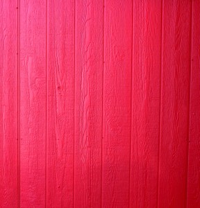 Free photo of a wall of wood paneling painted red