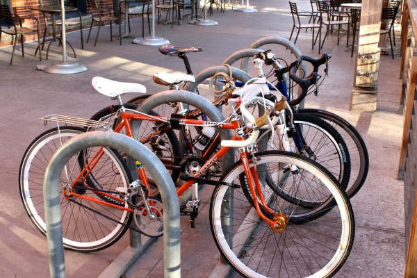 bicycles parked at bike rack - free high resolution photo
