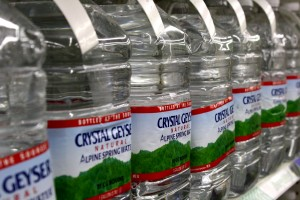 Free high resolution photo of a store shelf full of bottled water