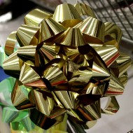 free high resolution photo of a gold colored gift bow