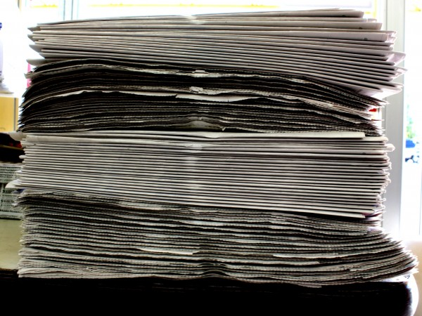 free high resolution photo of a stack of newspapers