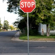 free high resolution photo of a stop sign on a neighborhood street corner