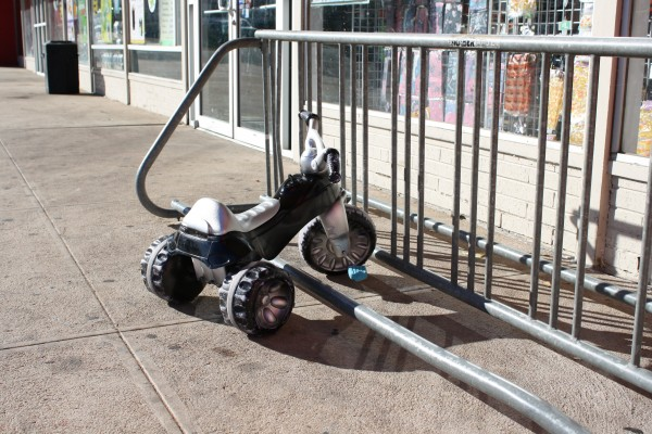 free high resolution photo of a tricycle parked at a bike rack