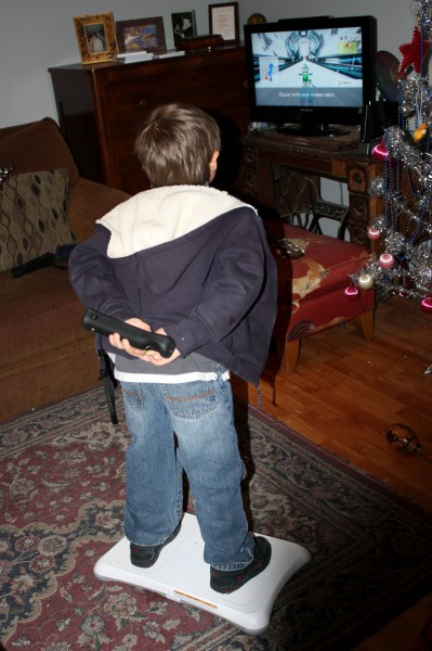 Child Playing with Wii Fit - free high resolution photo