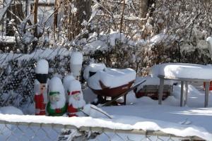 Snow Covered Christmas Figurines, Wheelbarrow, Table and Wagon - Free High Resolution Photo