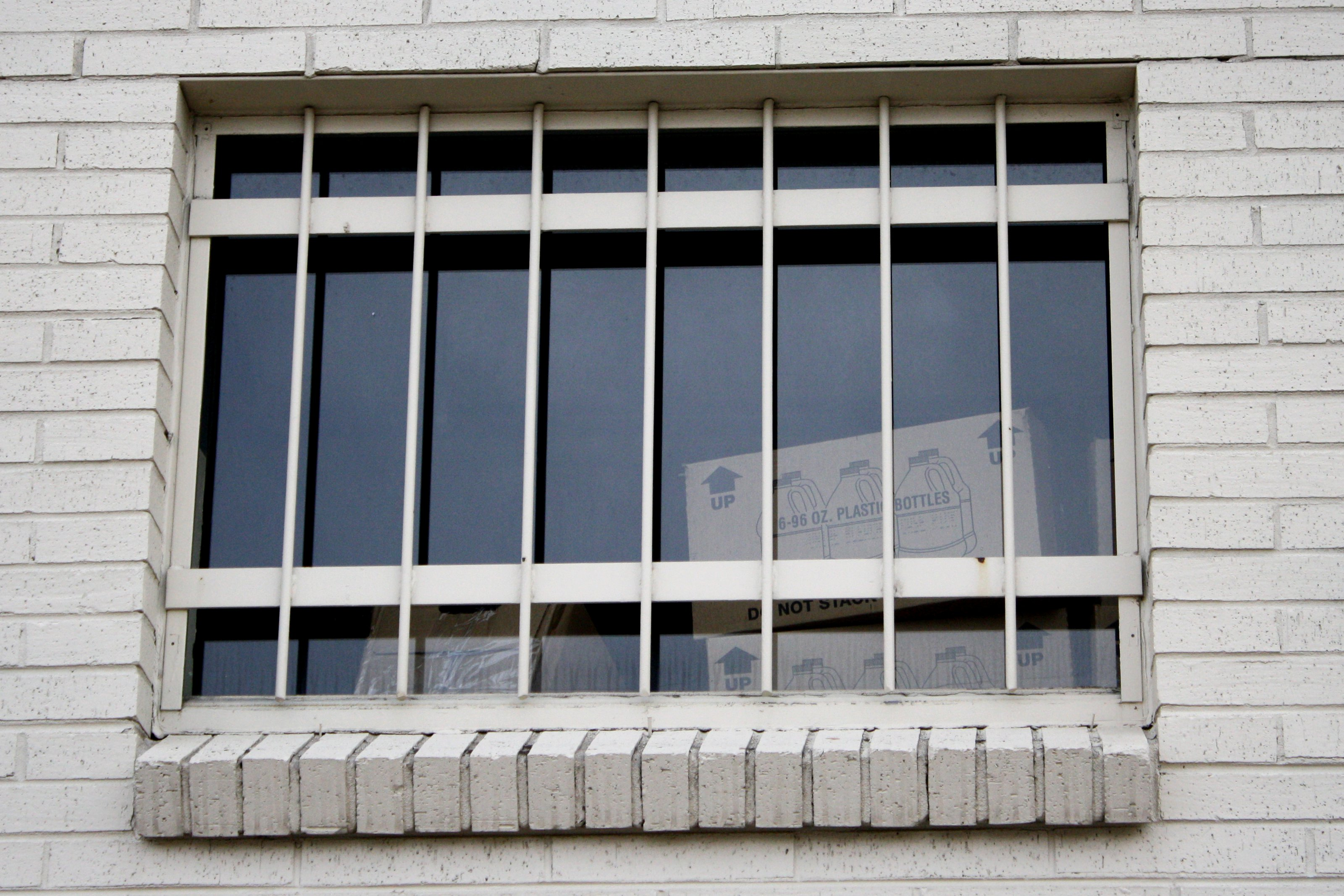 Window with security bars picture free photograph