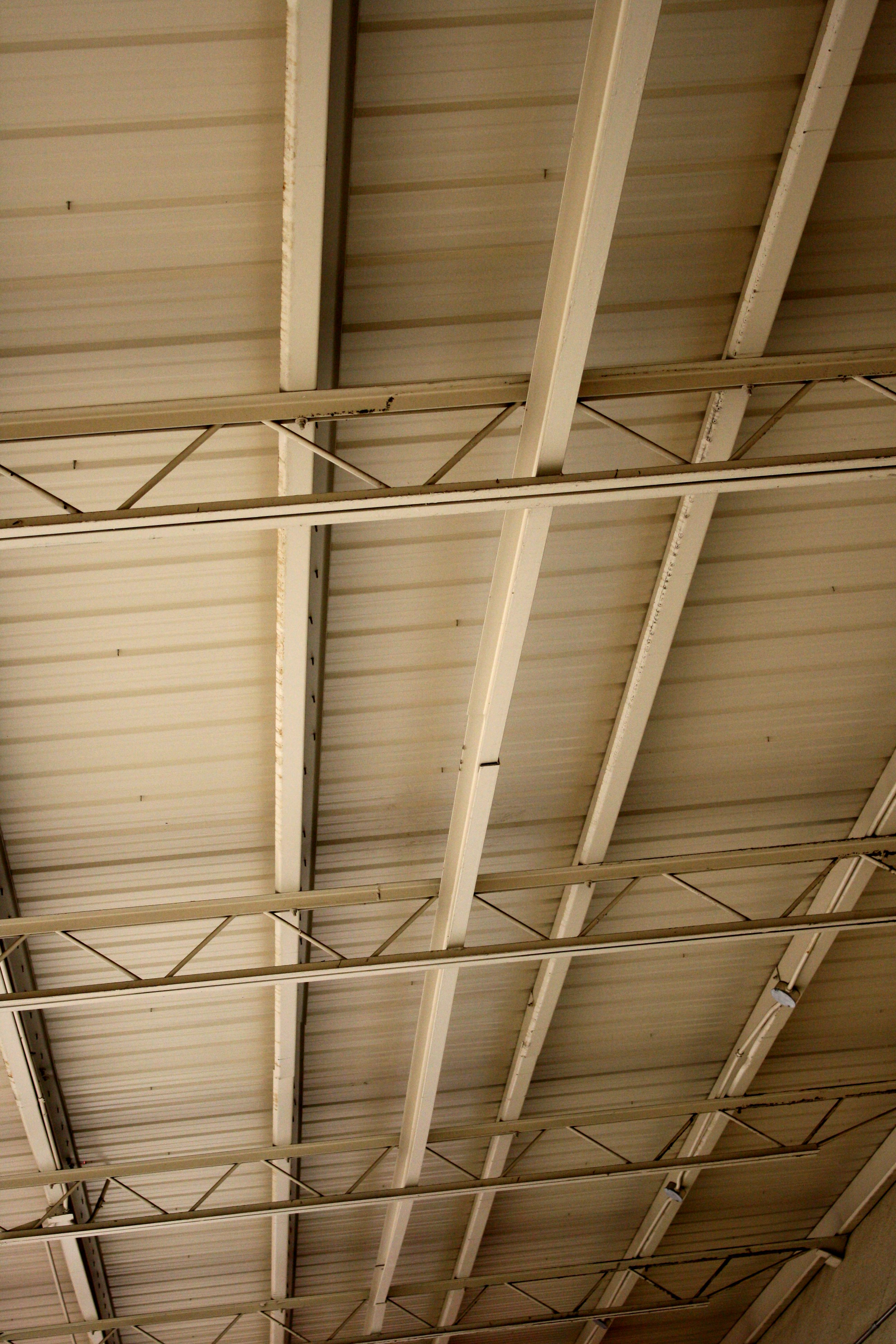 Underside Of Metal Roof With Support Beams And Girders