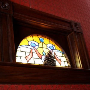 Half Circle Stained Glass Window with Pinecone on Sill - Free High Resolution Photo