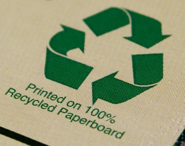 Recycling Arrows on Cardboard Box - Free Photo