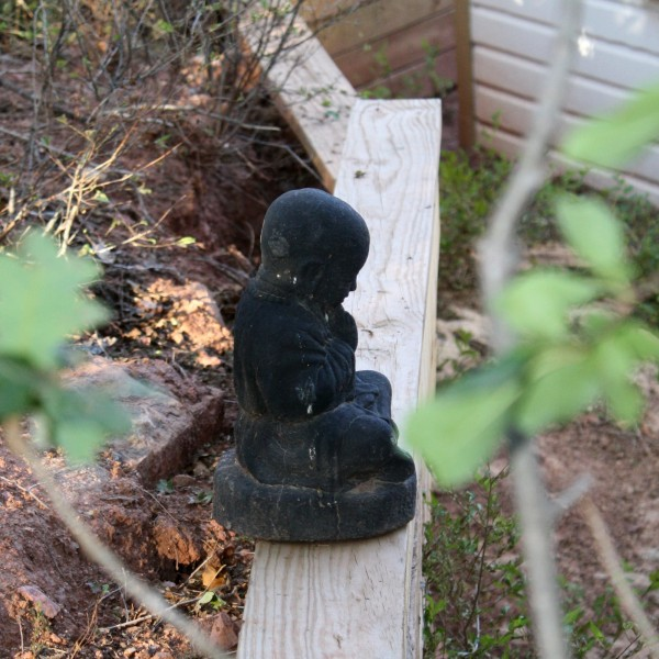 Buddha Statue on Outdoor Retaining Wall - Free High Resolution Photo