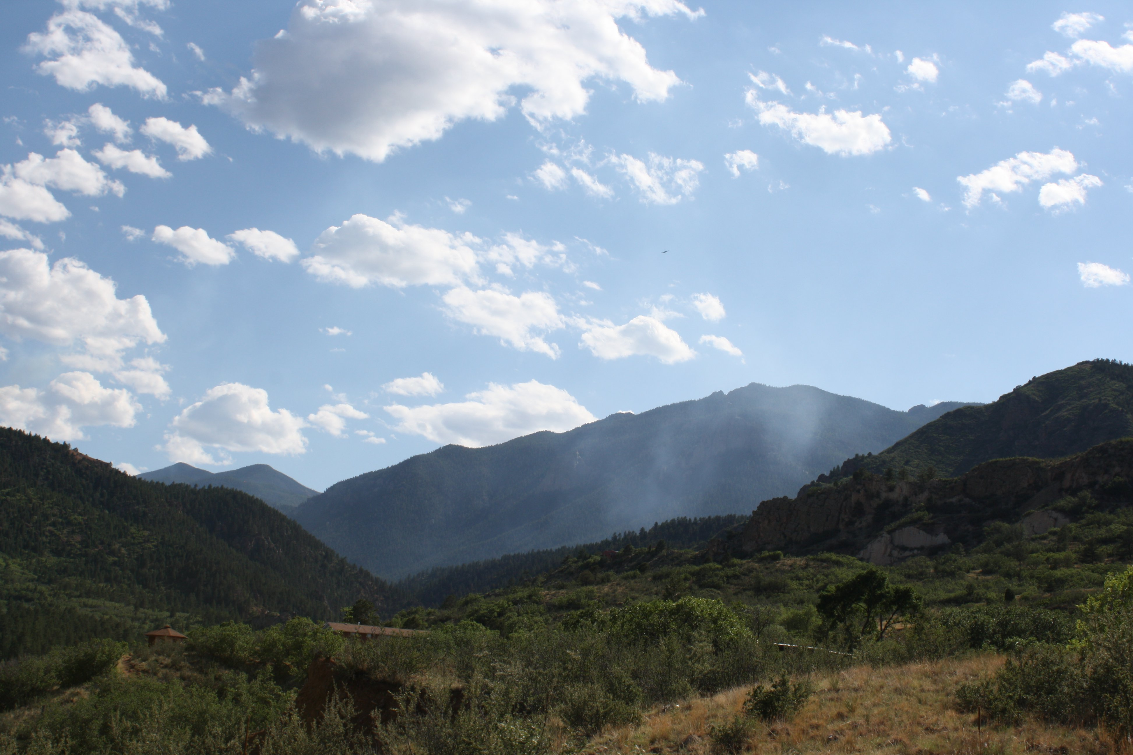 Smoke Rising From Mountain Pass Picture Free Photograph