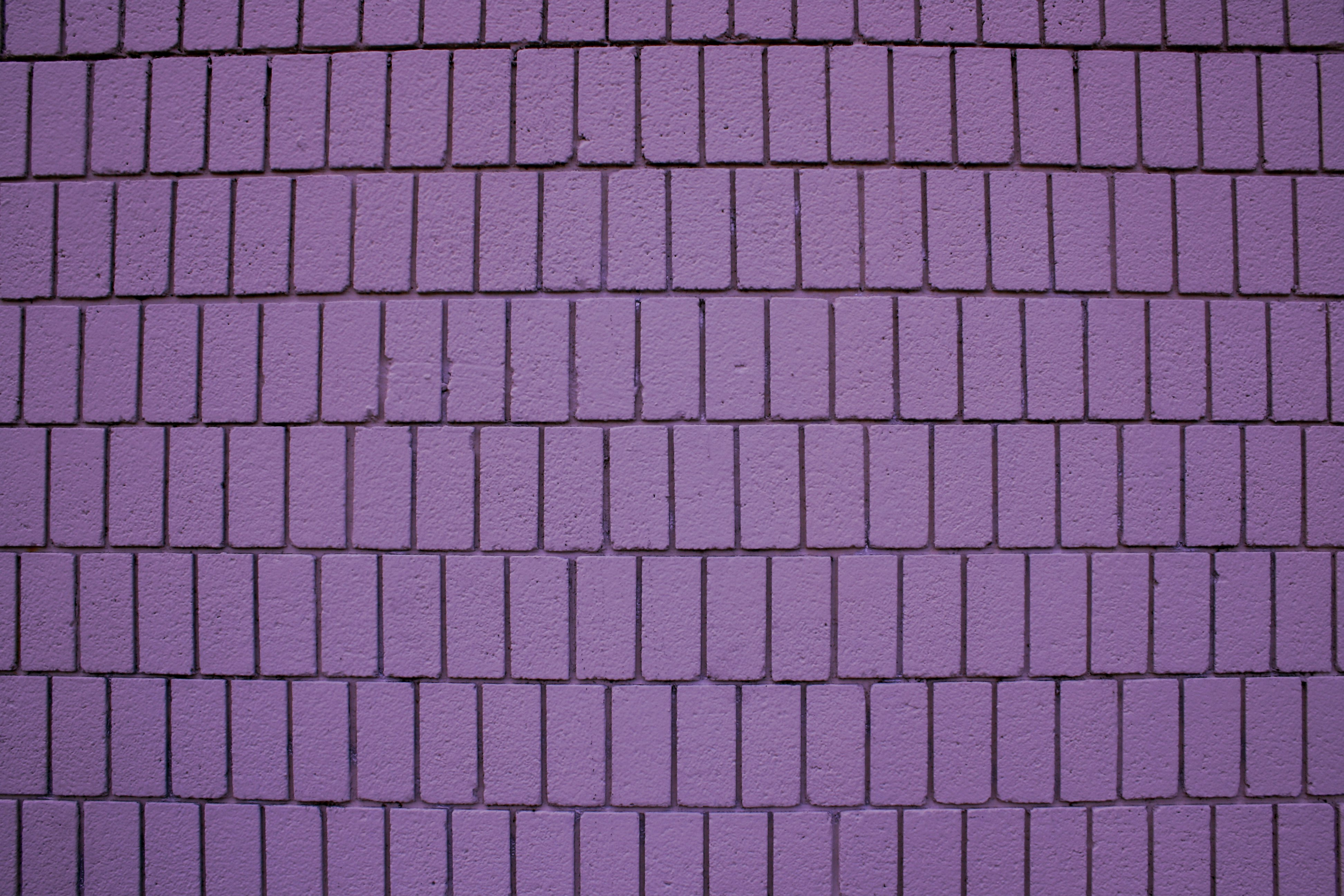 Dusty purple brick wall texture with vertical bricks for Purple brick wallpaper