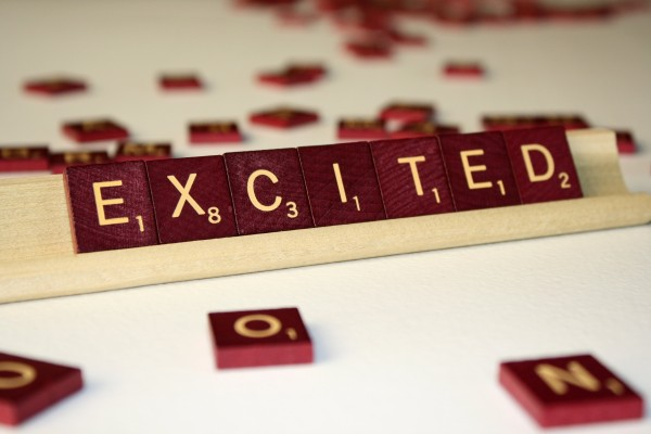 Excited - Free High Resolution Photo of the word Excited spelled in Scrabble tiles