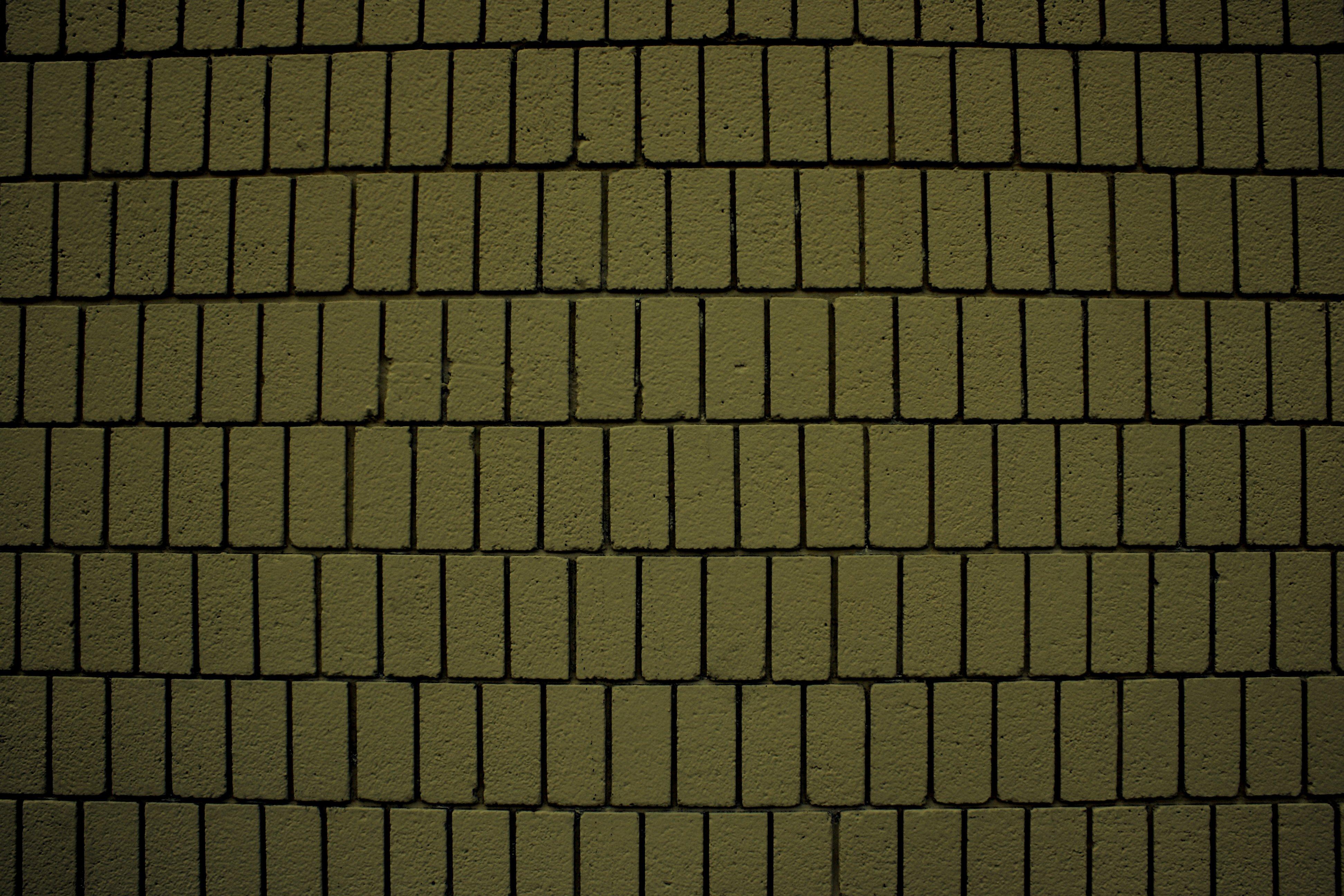 Khaki olive green brick wall texture with vertical bricks for Khaki green walls