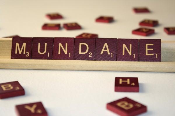 Mundane - Free High Resolution Photo of the word Mundane spelled in Scrabble tiles