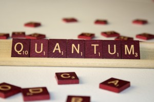 Quantum - Free High Resolution Photo of the word Quantum spelled in Scrabble tiles