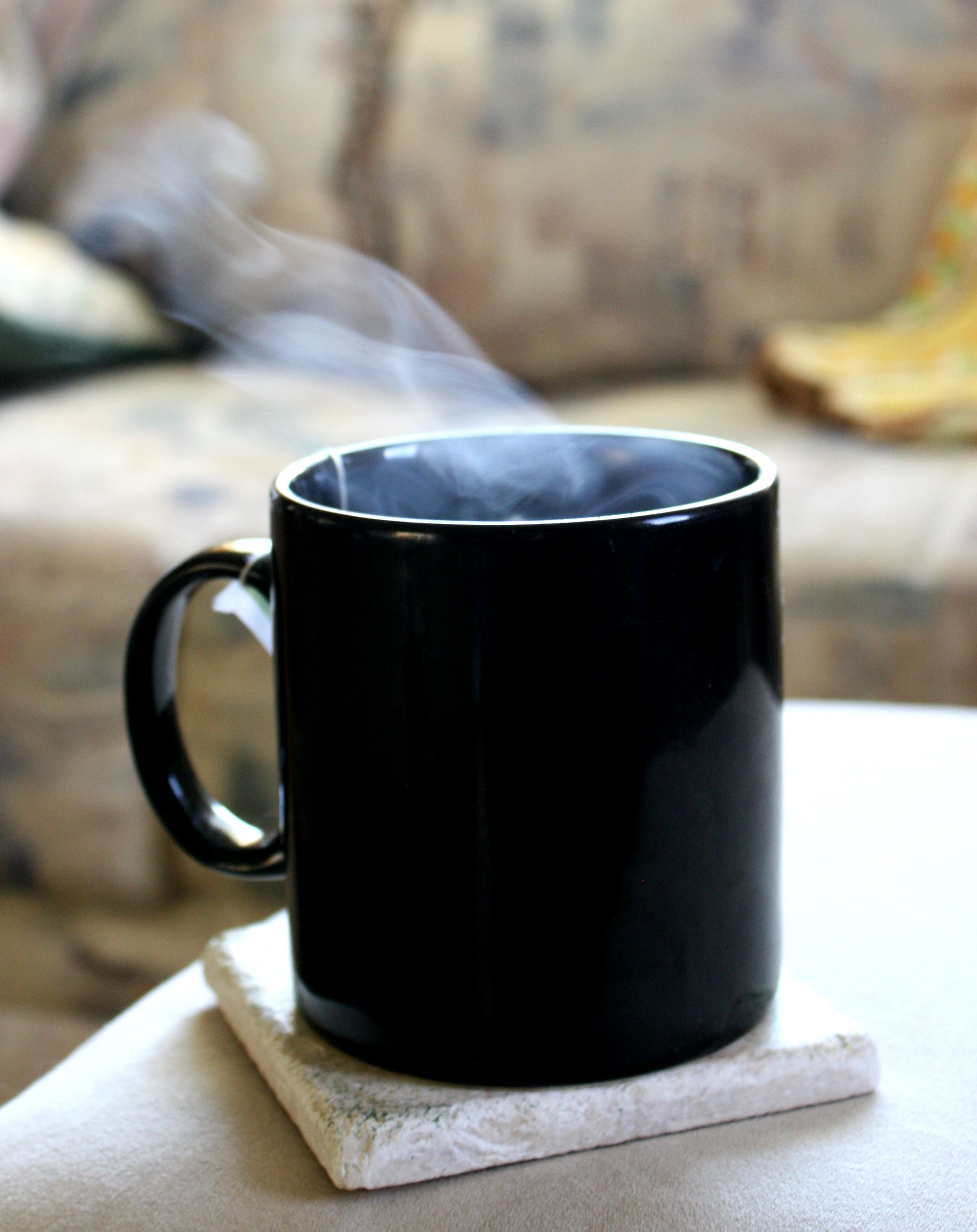 Steam Rising From Cup Of Hot Tea