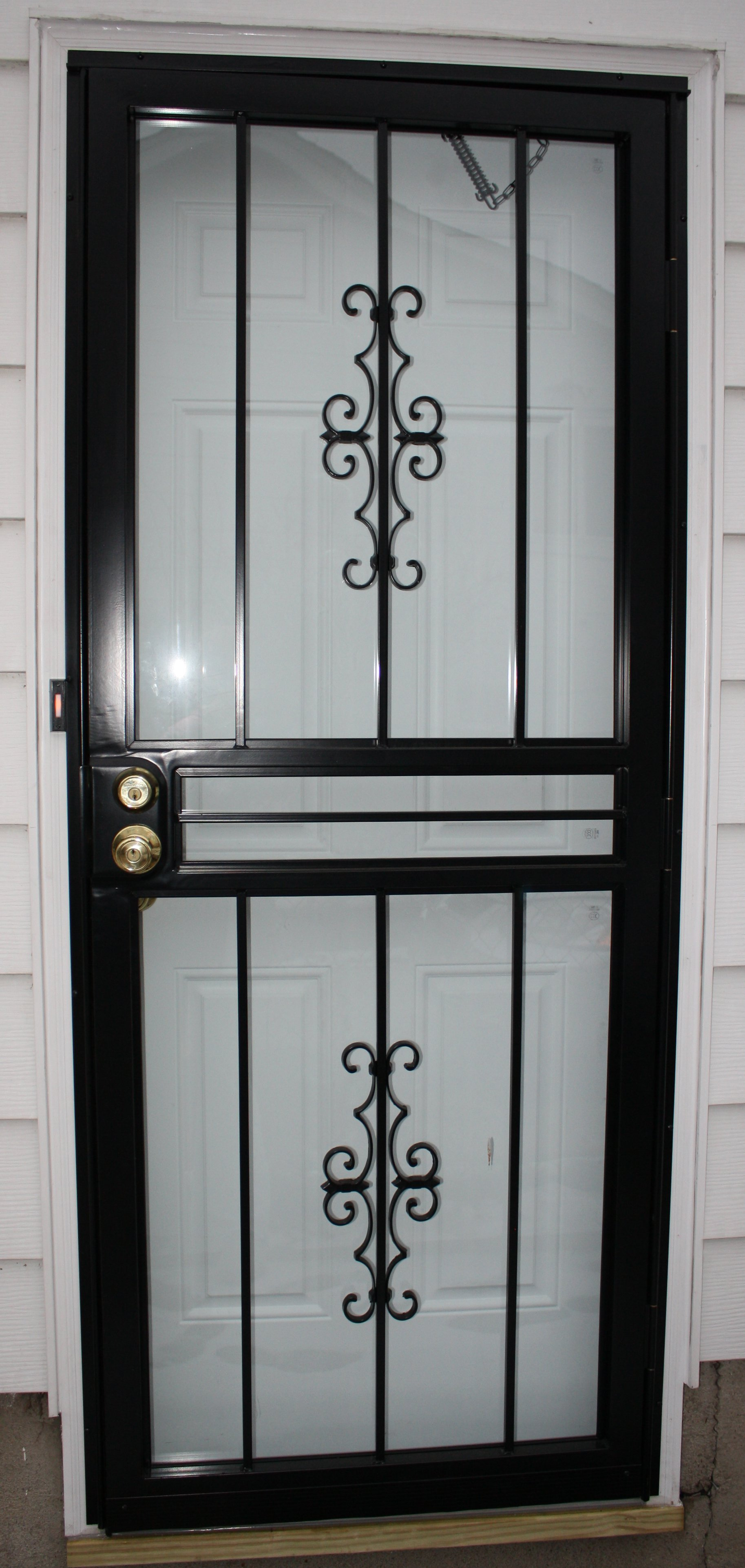 Security screen doors wrought iron security screen door for Metal security doors