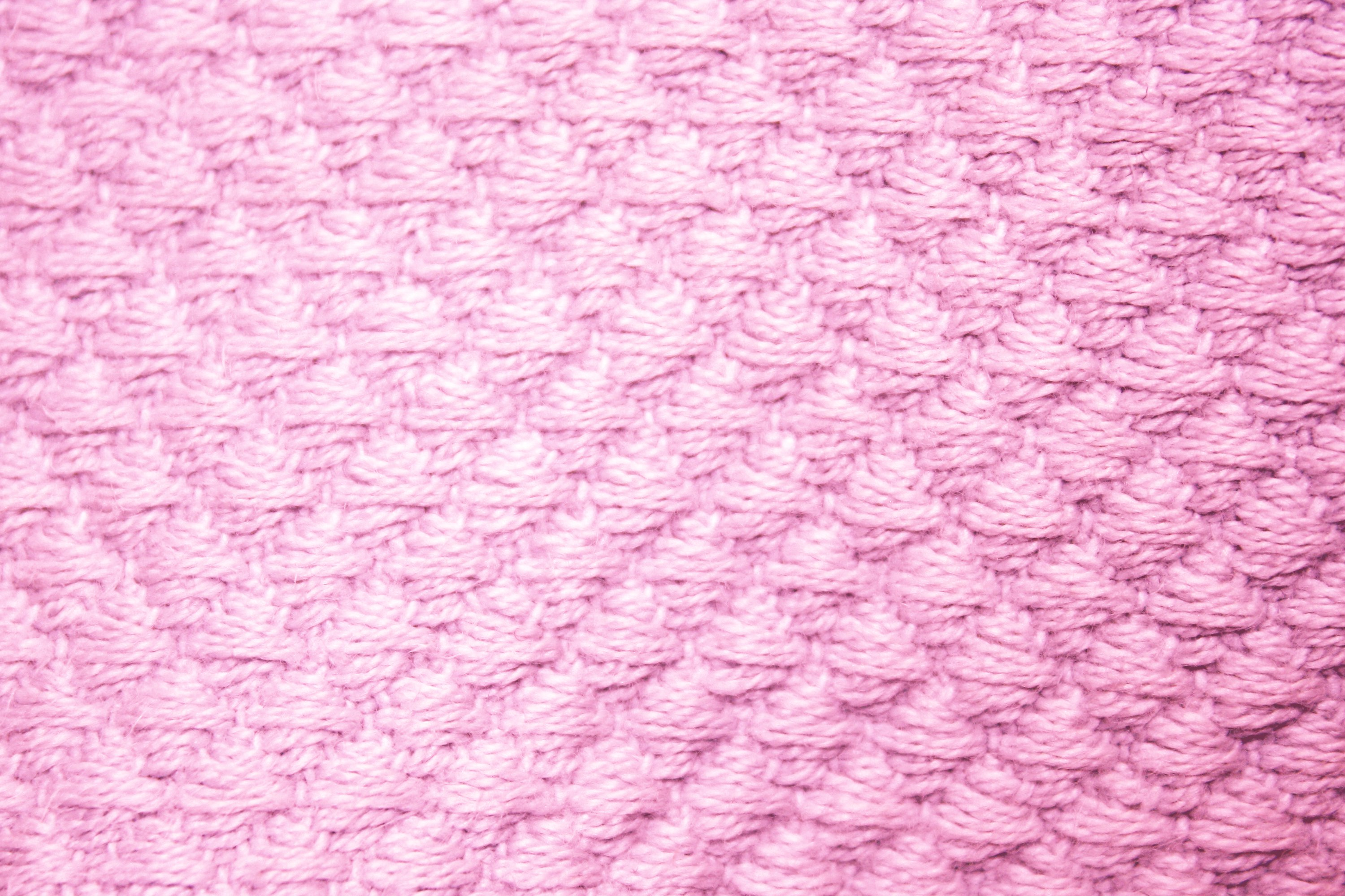 Pink bed sheet texture - Pink Diamond Patterned Blanket Close Up Texture