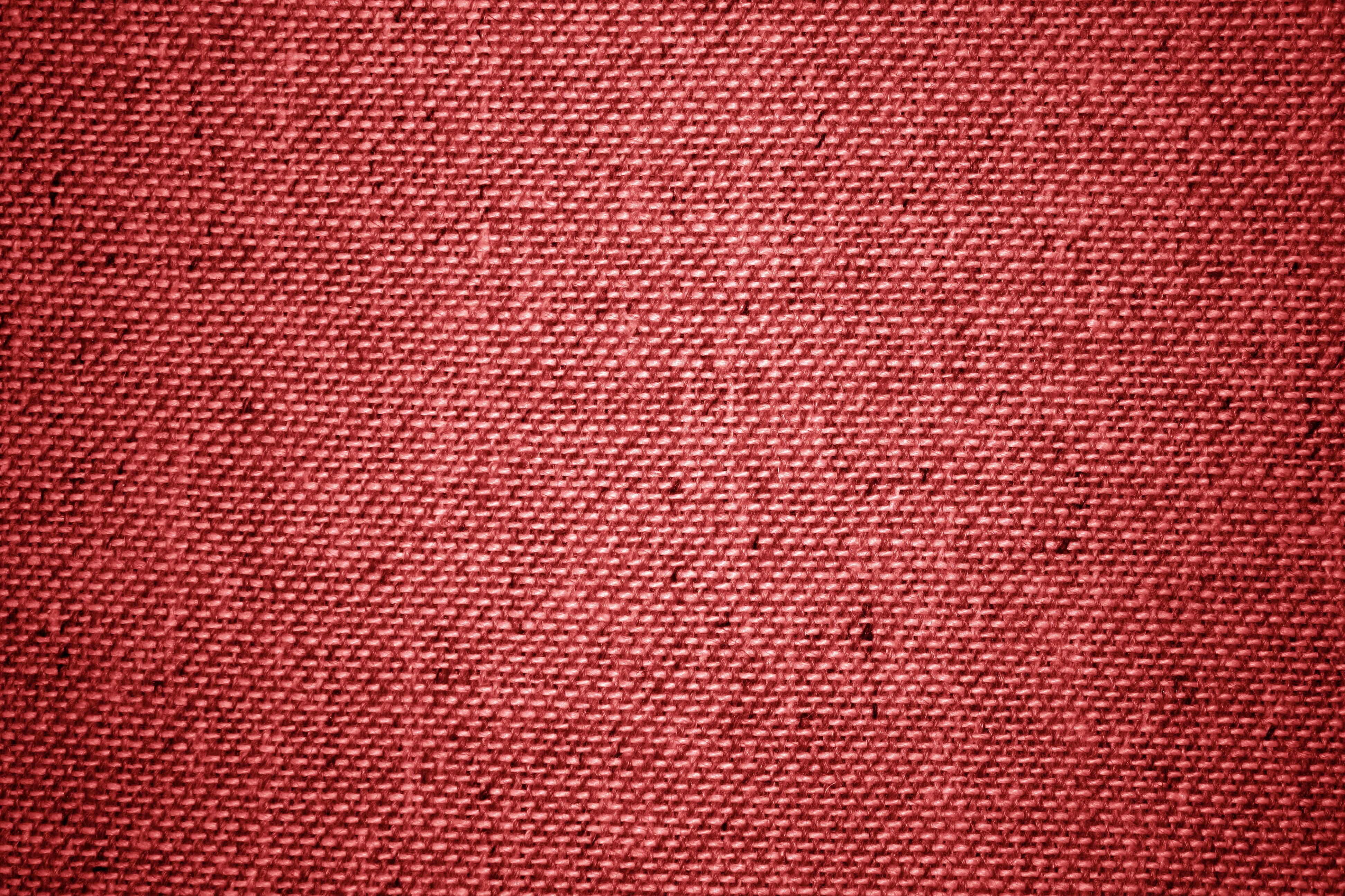 red upholstery fabric close up texture