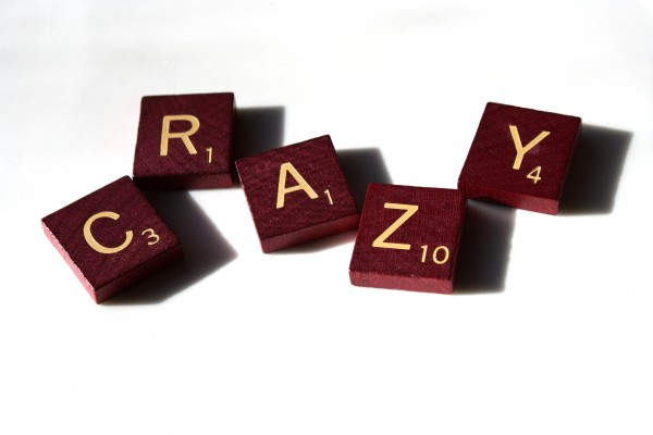 Crazy - free high resolution photo of Scrabble letter tiles spelling the word crazy