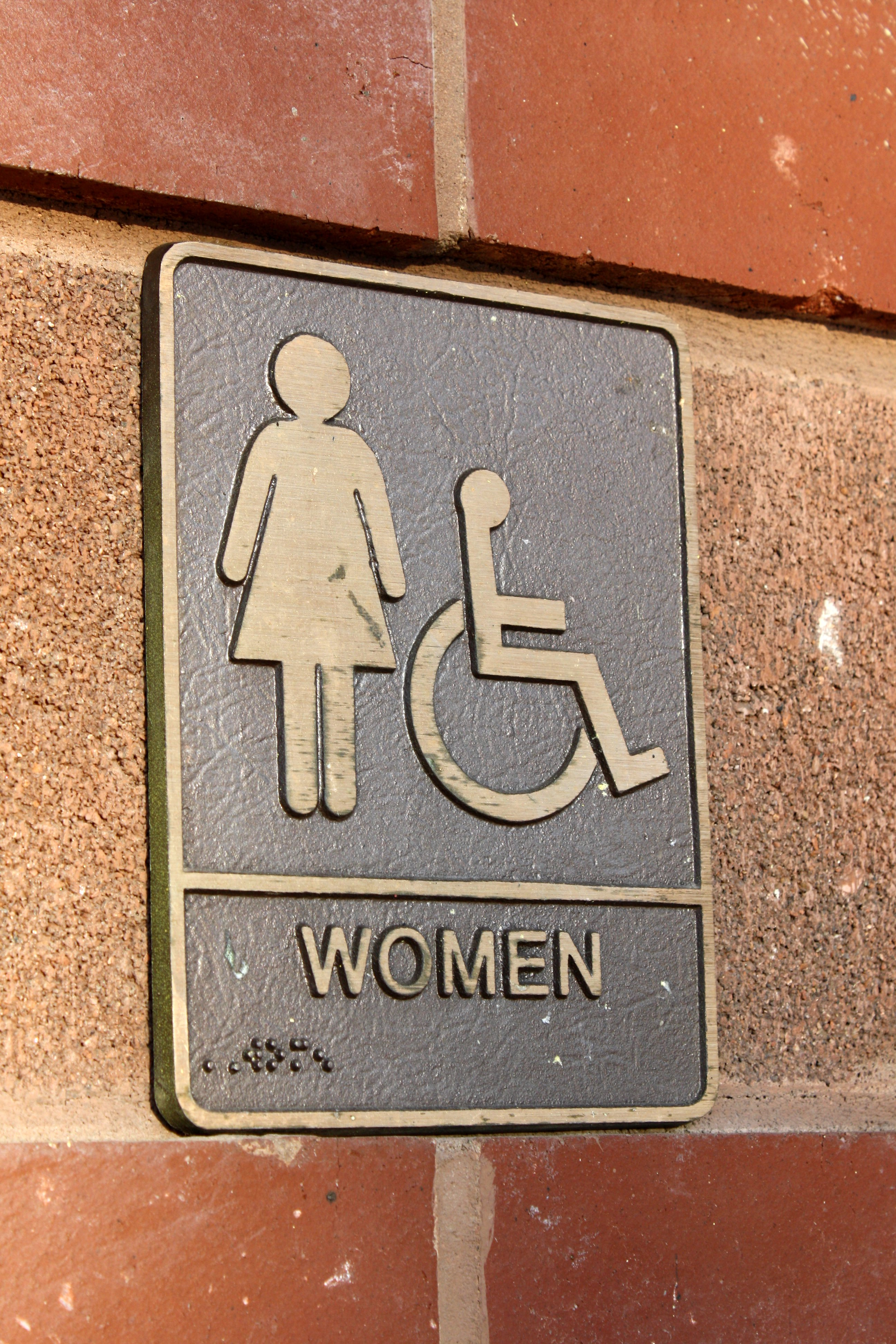 Bathroom Signs Commercial women's restroom sign brass plaque picture | free photograph