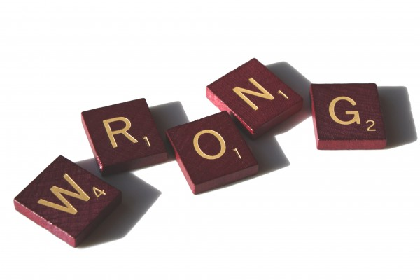 Wrong - free high resolution photo of Scrabble tiles spelling the word wrong
