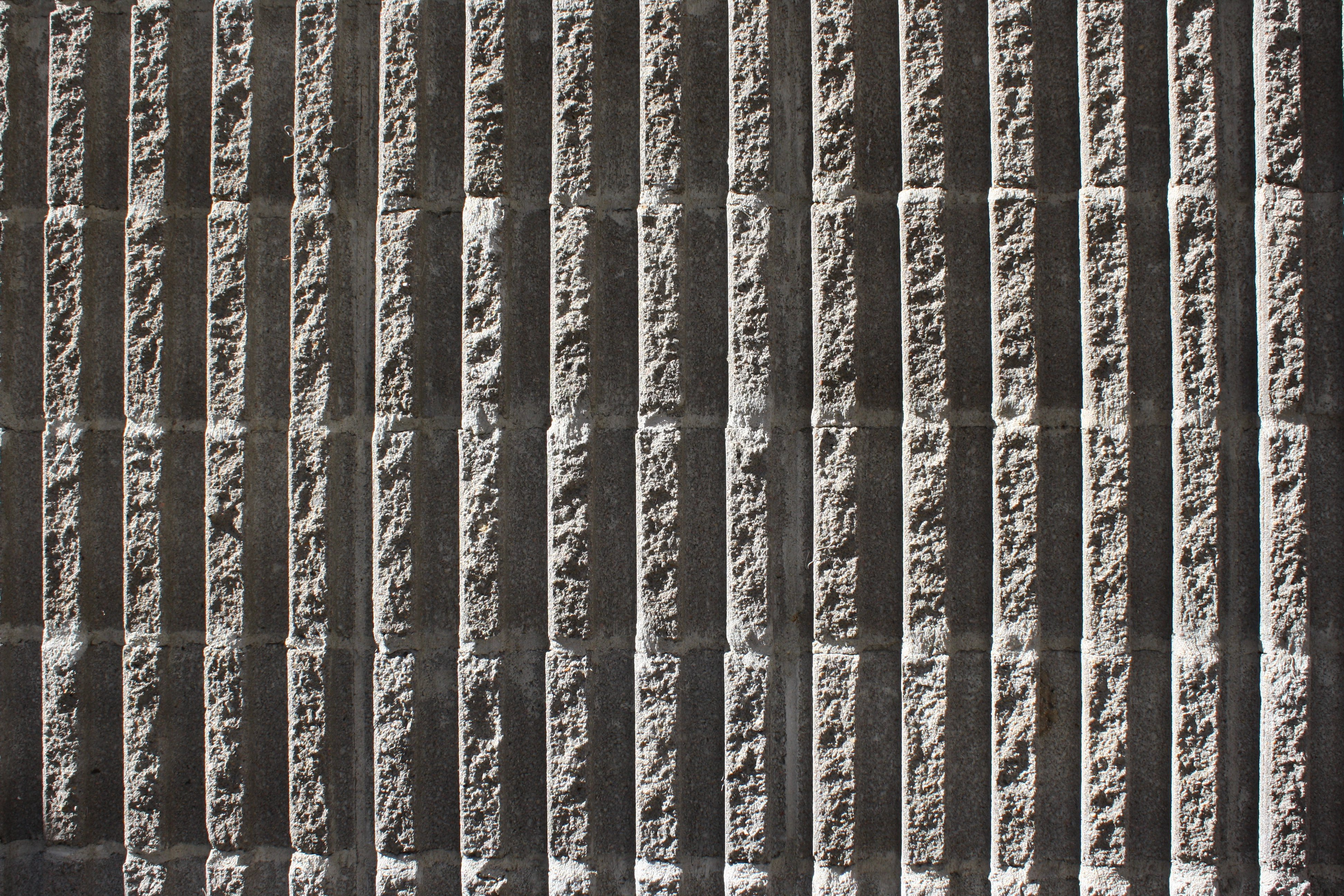 Fluted Concrete Block Wall Texture With Vertical Ridges