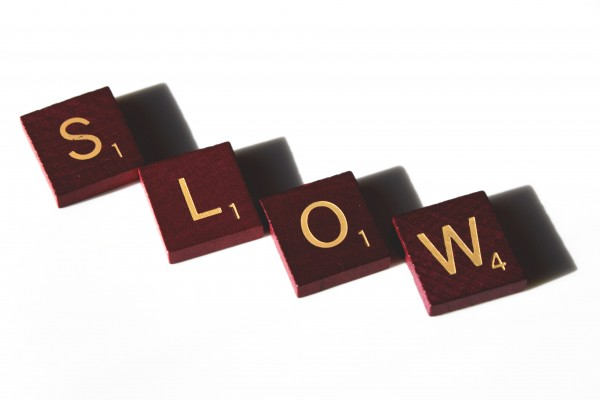 Slow spelled in Scrabble letter tiles - Free high resolution photo