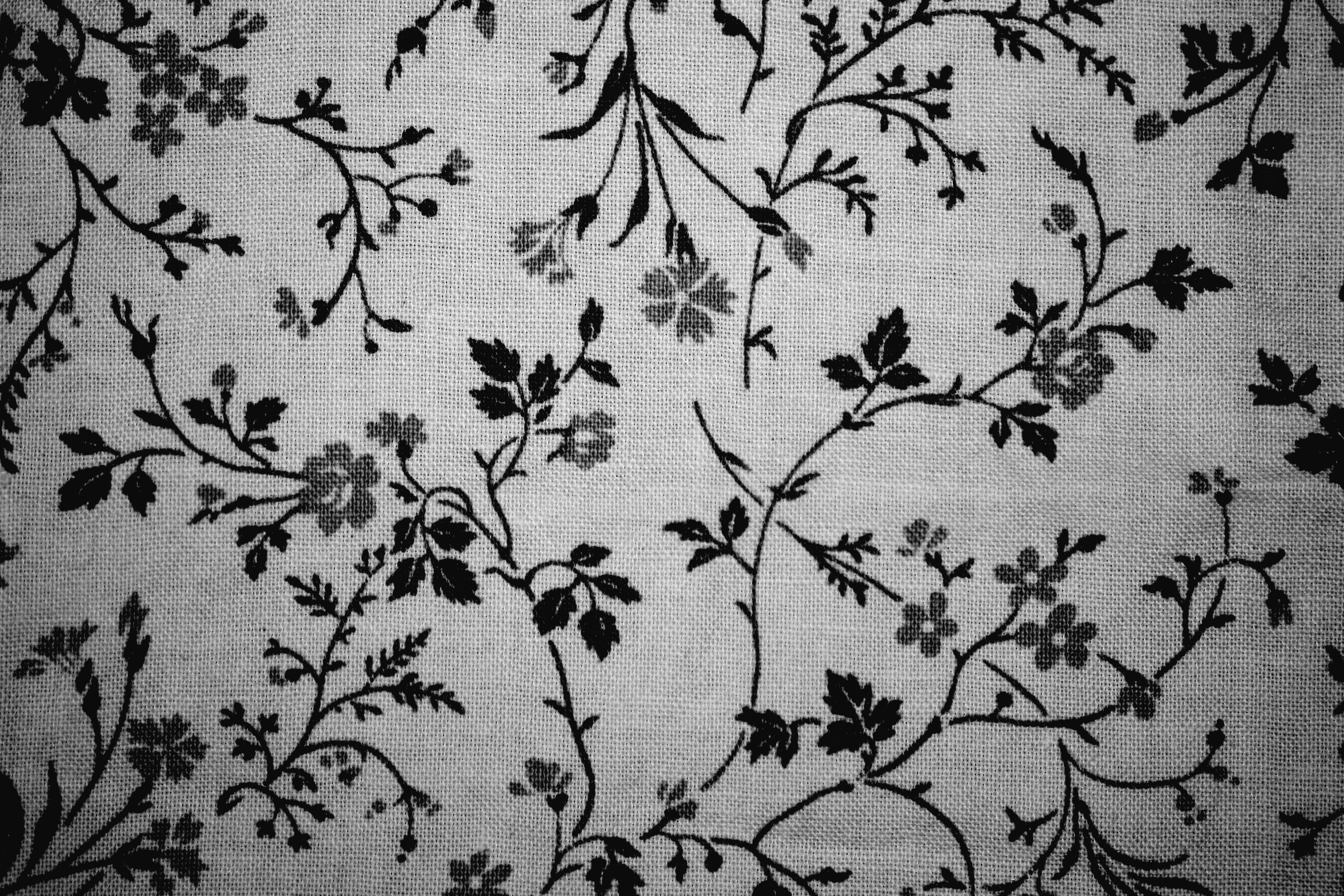 Black on white floral print fabric texture