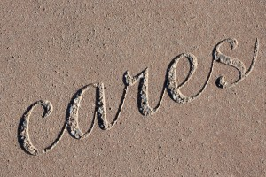 "Cares - The Word ""Cares"" Set in Concrete - Free High Resolution Photo"