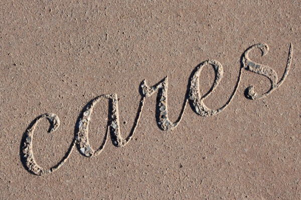 """Cares - The Word """"Cares"""" Set in Concrete - Free High Resolution Photo"""