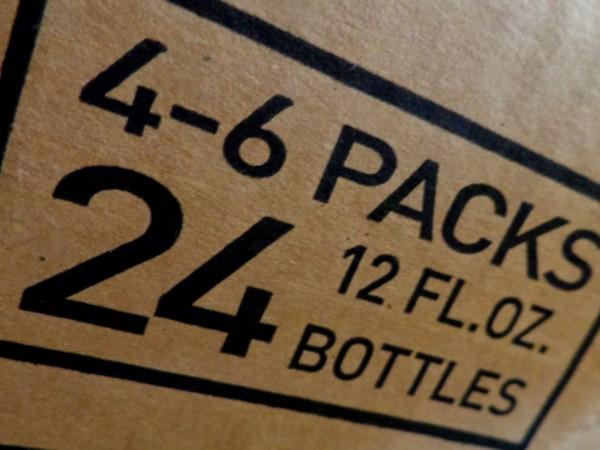 4 Six Packs - 24 Bottles - Sign Printed on Cardboard Box - Free High Resolution Photo