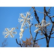 snowflake-light-decorations-in-tree-branches-thumbnail