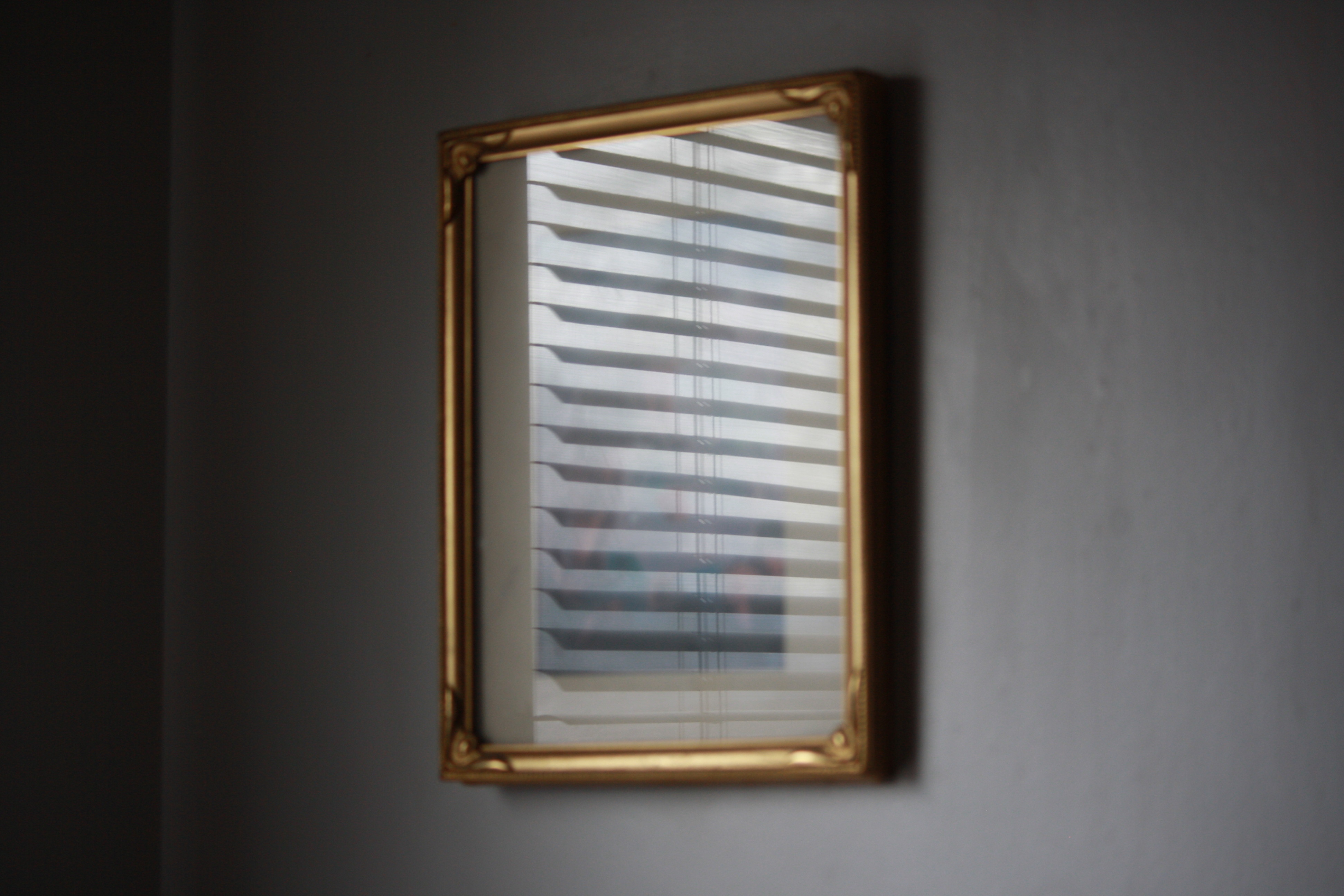 mini blind reflected in picture frame glass free high resolution photo