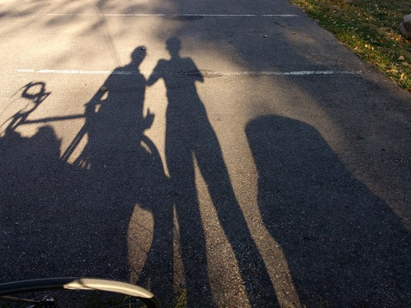 Elongated Shadows of Two People and a Bike - Free High Resolution Photo