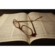 reading-glasses-atop-pages-of-open-dictionary-book-thumbnail