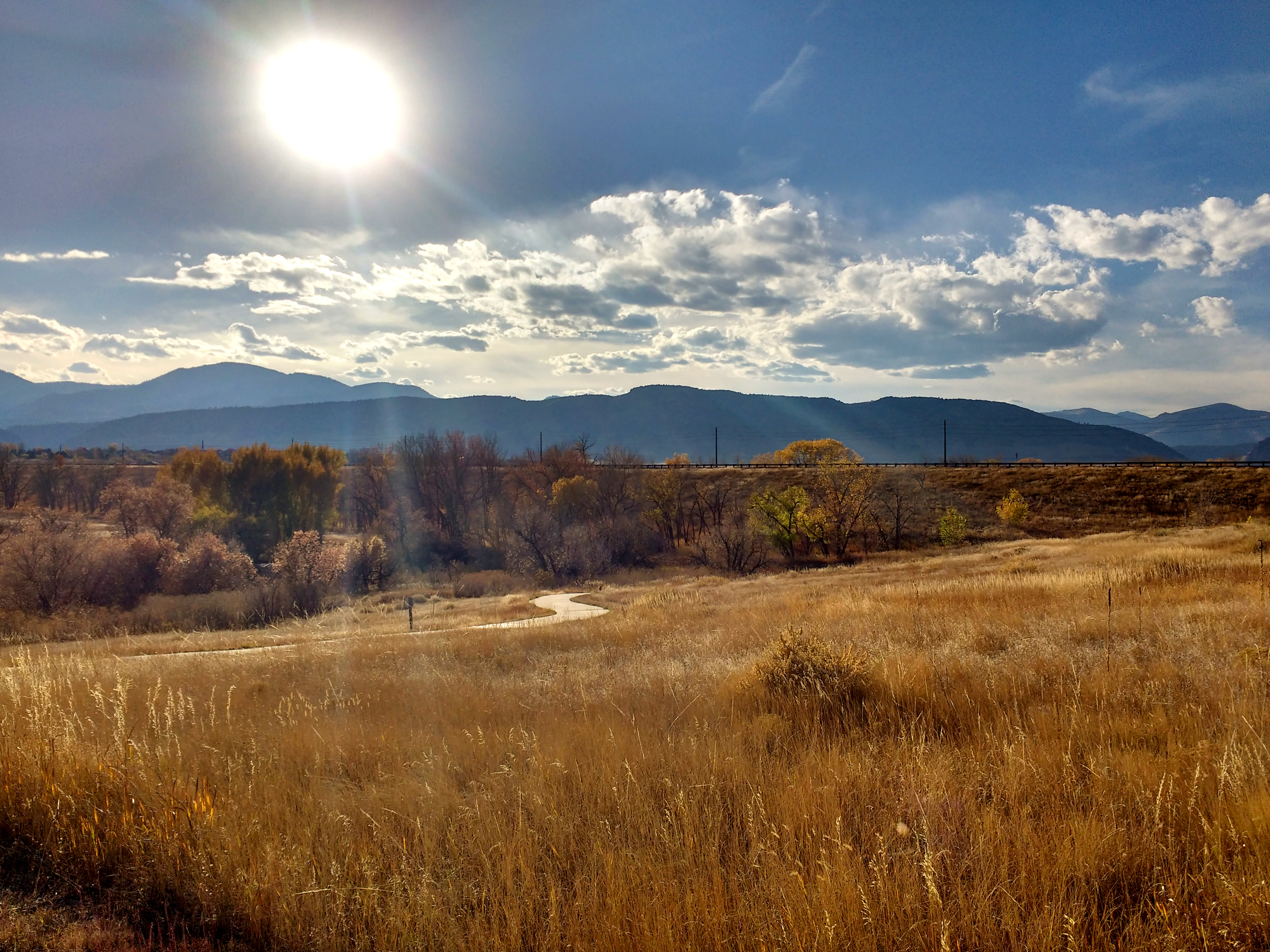 autumn sun over prairie and mountain landscape picture