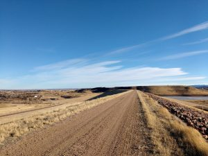 Dirt Road Across Top of Dam - Free High Resolution Photo
