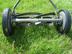 photo of hand push reel lawn mower in grass